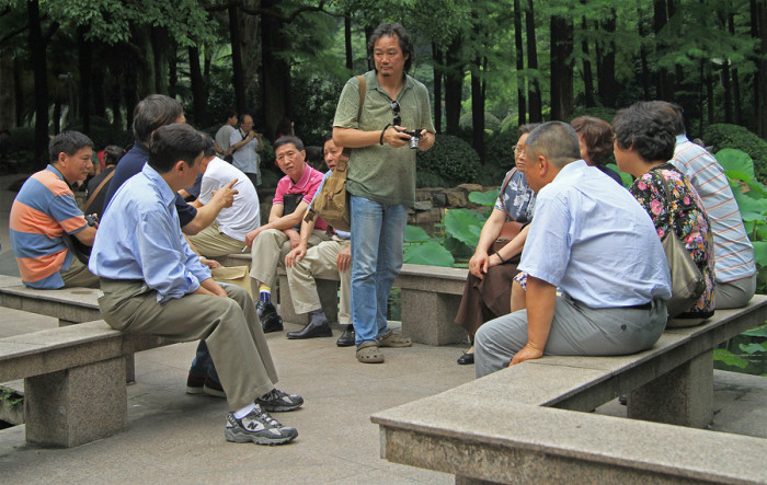 chinese people are communicating in park of Shanghai, China