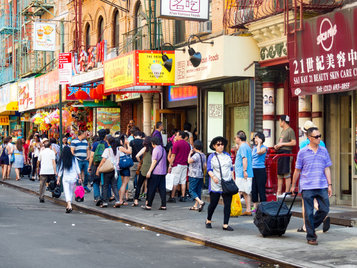 NEW YORK,USA – AUGUST 15,2015 : Tourists and chinese immigrants